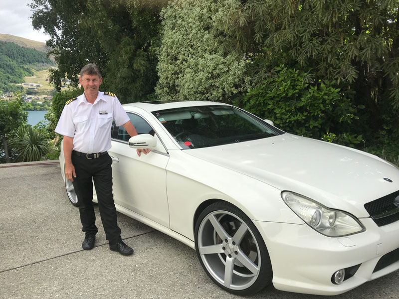 Wayne Perkins, owner of QUeenstown Lake Cruise with their vehicles